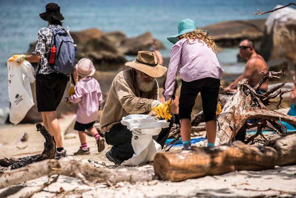 Removing litter from a Queensland beach